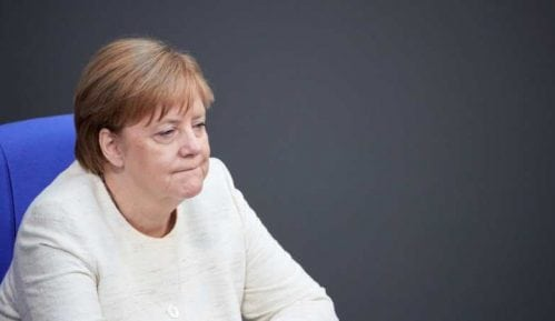 Merkel: Ustupak Trampu 15