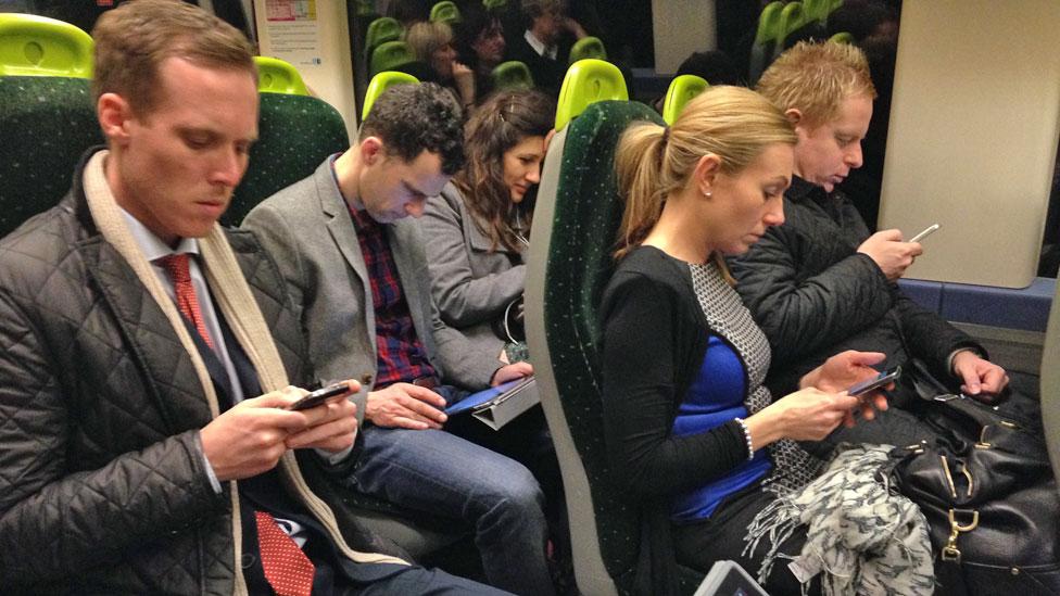 putnici sa telefonima