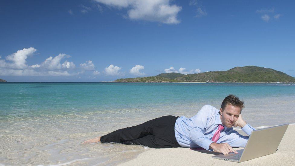 Man in suit on beach