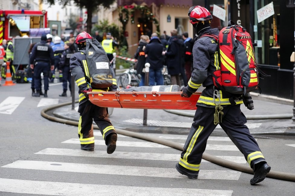 Emergency workers carry a stretcher