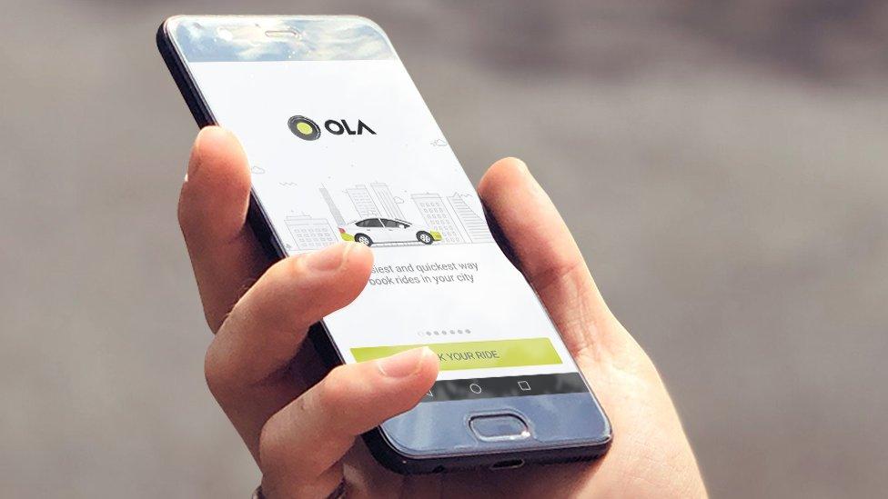 Ola on a phone