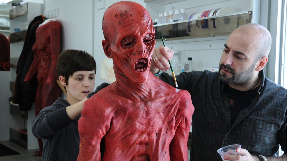 David Marti and another artist applying Javier's costume