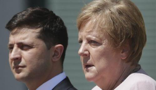 Angelu Merkel uhvatila drhtavica za vreme zvanične ceremonije 3