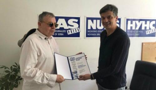 Počasna članska karta NUNS-a reditelju Goranu Markoviću 8