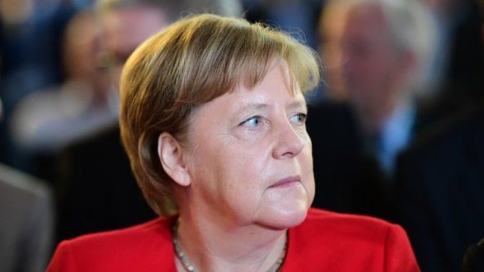 Merkel kritkovala Trampa 4