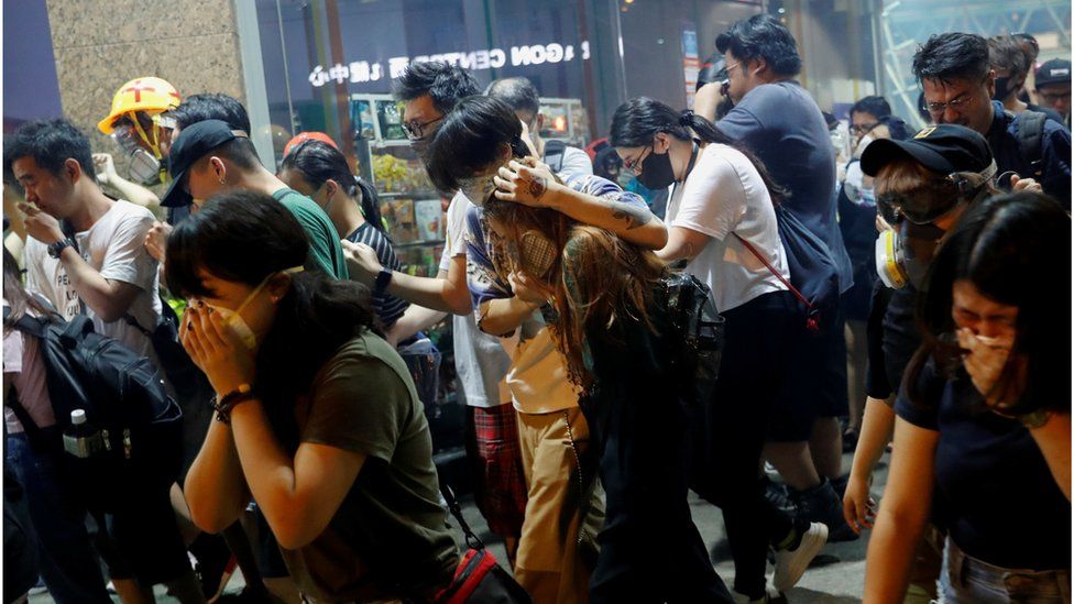 Anti-extradition bill protesters react after the police fired tear gas to disperse the demonstration at Sham Shui Po, in Hong Kong, China August 14, 2019.