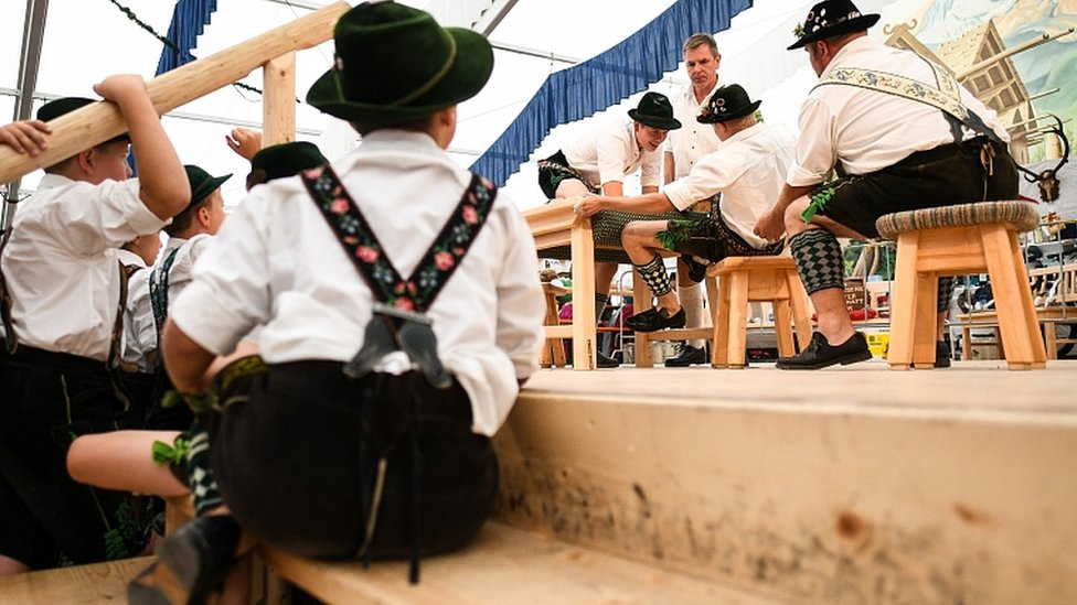 Children watch competitors face off in the German Finger Wrestling (Fingerhakeln) Championships in Garmisch-Partenkirchen, southern Germany, 15 August 2019