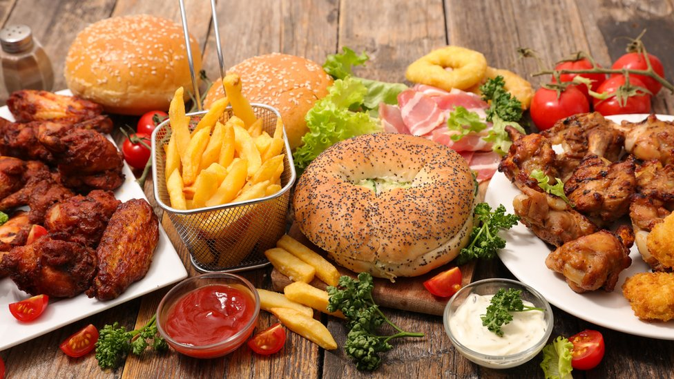 Variety of fast food including hamburgers, chicken wings, chips etc.