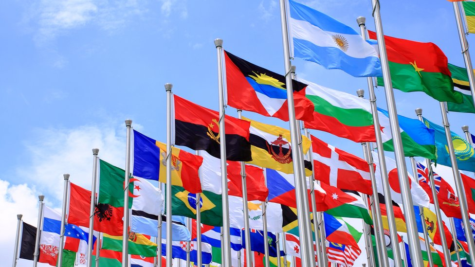 Flags from all over the world, flying on masts.