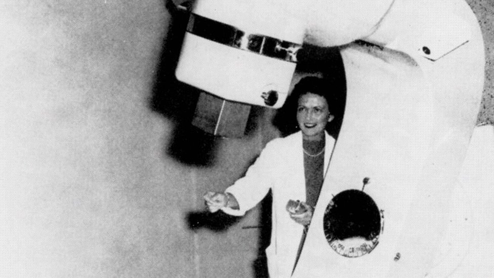 """Dr Vera Peters pictured with the """"Cobalt X-otron"""" bomb developed by scientific staff of the Ontario Cancer Institute, 1958"""