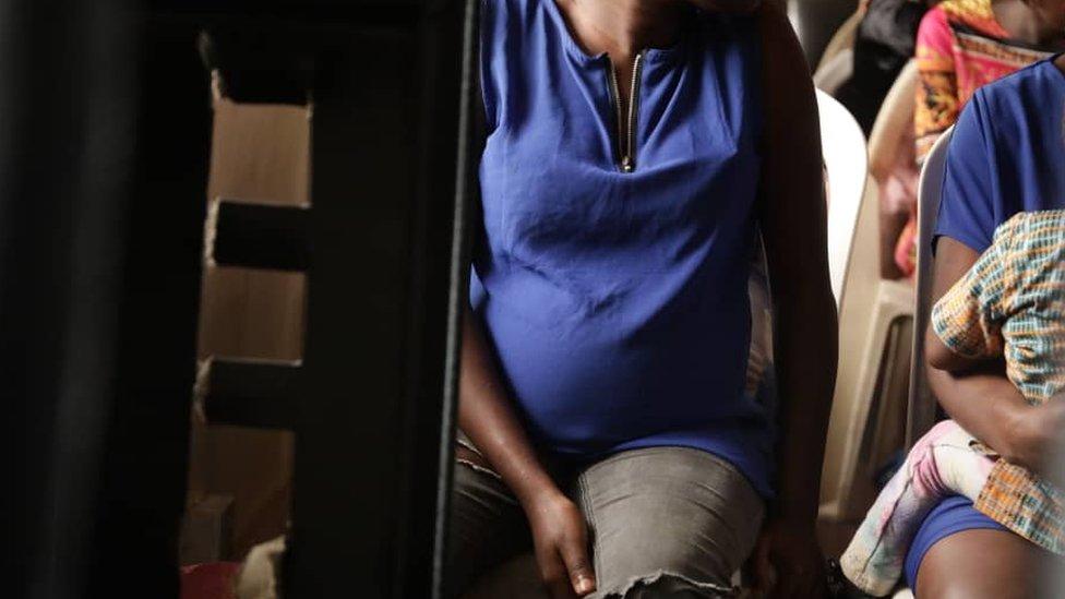 Unidentified pregnant woman