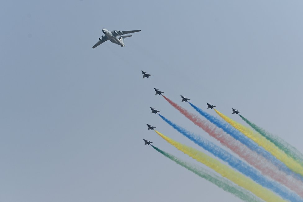 A formation of military aircraft fly over Beijing during the military parade.