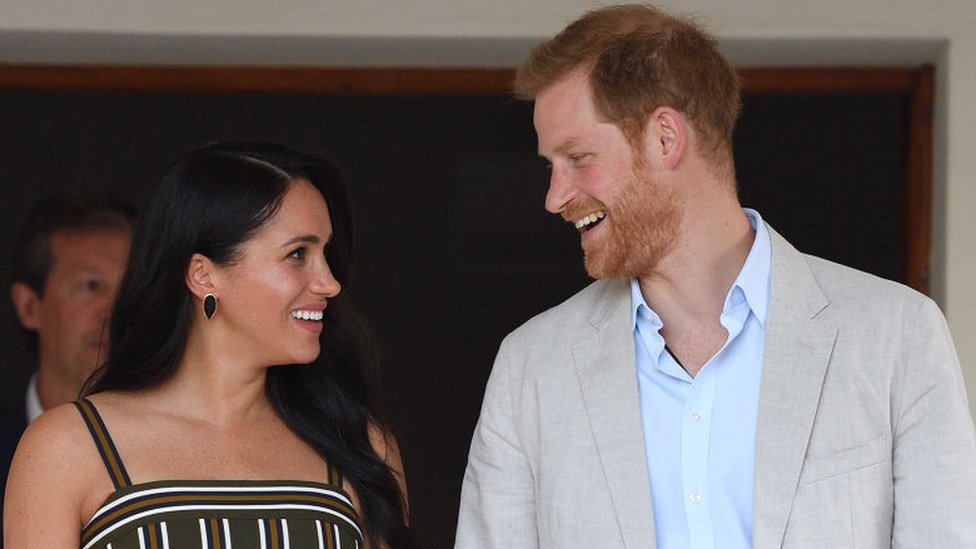 Meghan Markle and Prince Harry smiling at each other