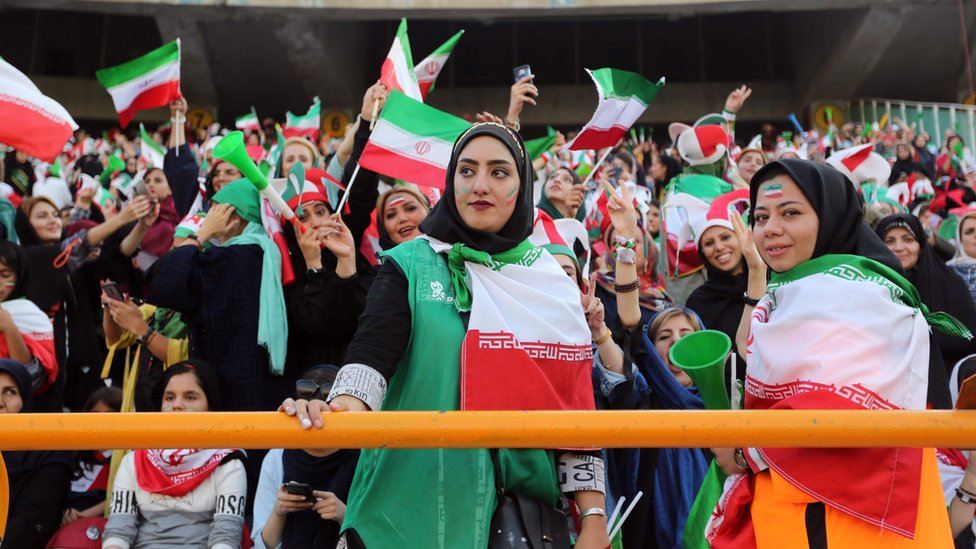 Iranian women cheer during the World Cup Qatar 2022 Group C qualification football match between Iran and Cambodia at the Azadi stadium in the capital Tehran on 10 October , 2019.