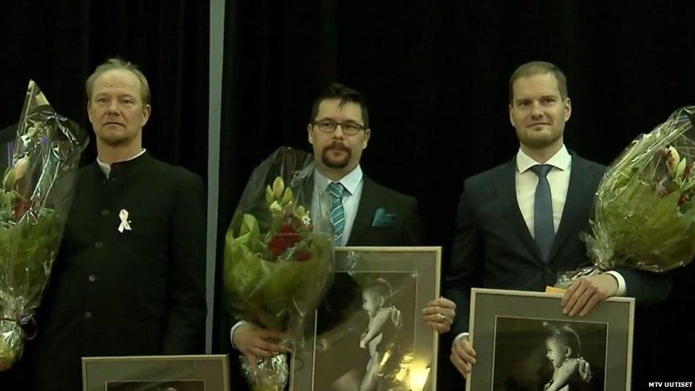Three recipients of Dad of the Year award