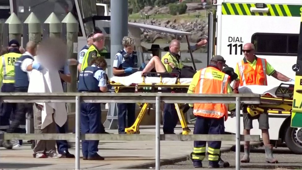 Rescue workers treat survivors in Whakatane