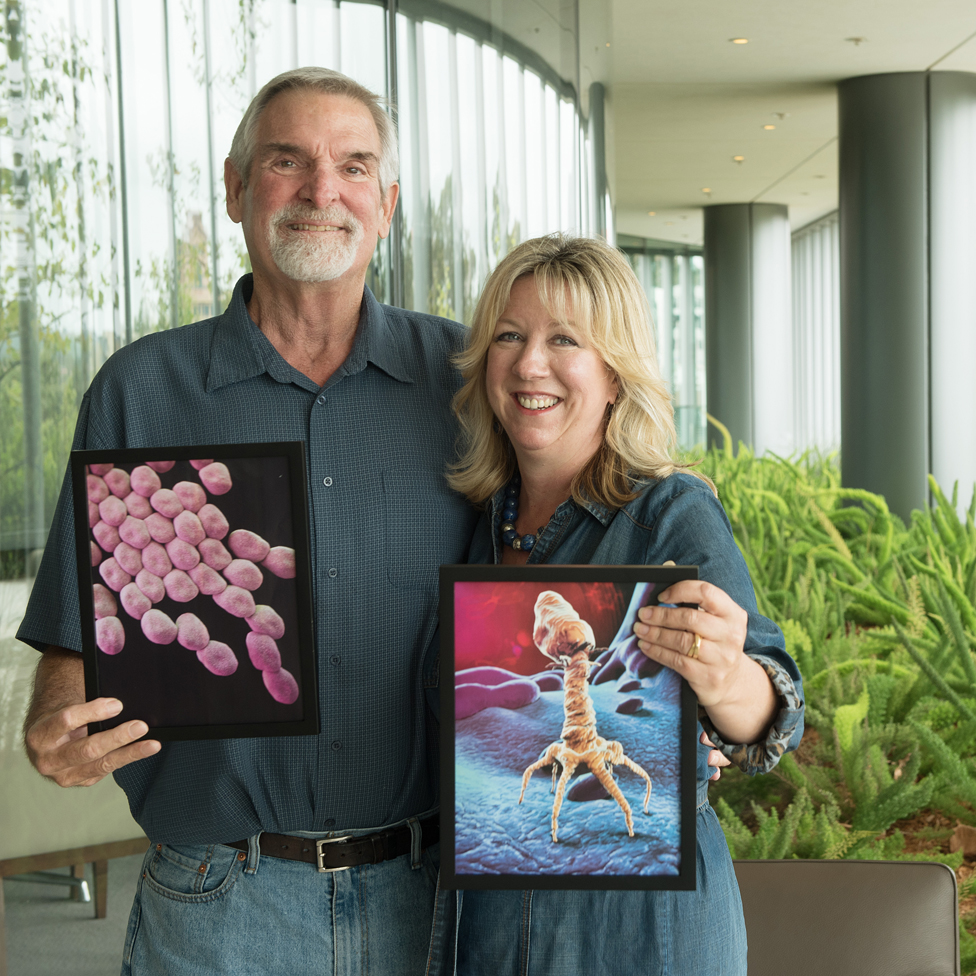 Tom holding an acinetobacter image, Steffanie holding an image of a phage