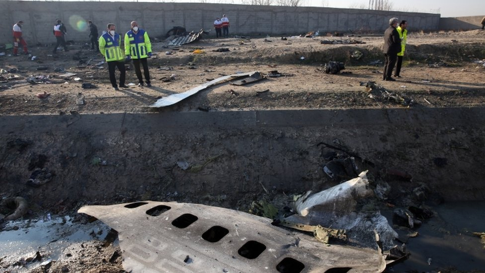 Search and rescue teams comb the wreckage of a Boeing 737 that crashed near Imam Khomeini Airport