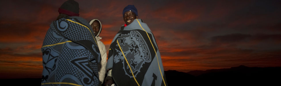 Men in Lesoth at dawn wearing traditional blankets