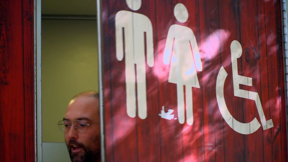 A man coming out of a toilet in Barcelona
