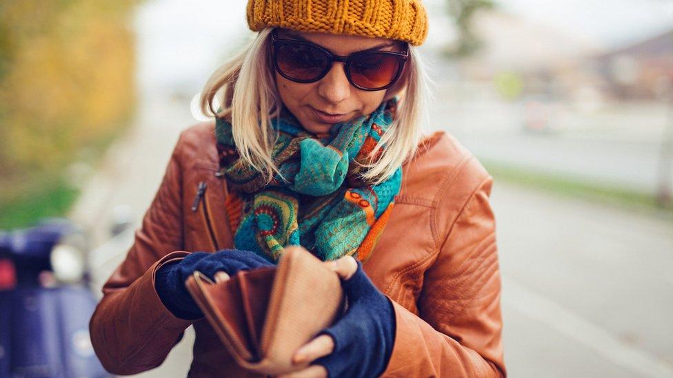Woman looking in wallet
