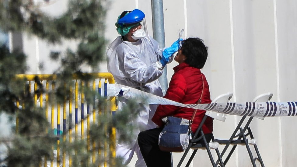 A woman is tested for coronavirus in Spain