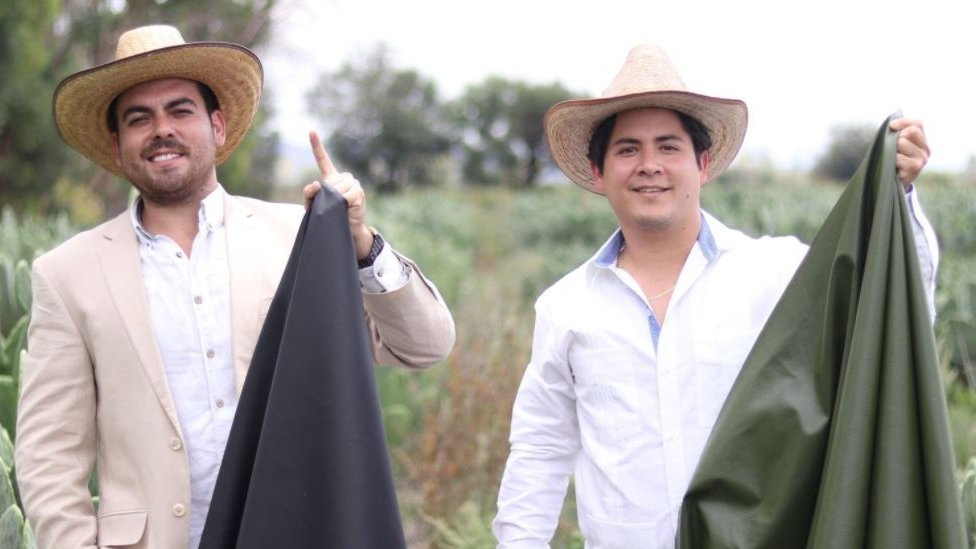 Adrian Lopez Velarde and Marte Czarez posing with the cactus leather