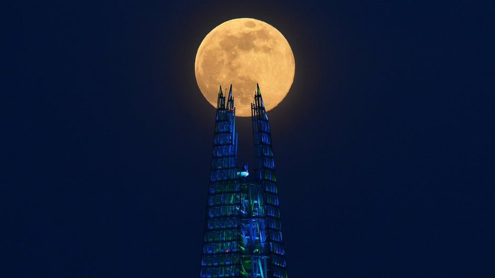 The Pink Supermoon rises over the Shard skyscraper in London