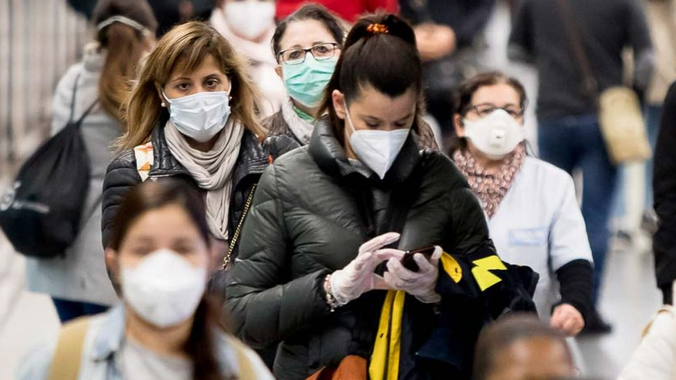 Red Cross volunteers have started to distribute more than a million health masks for free in Barcelona's metro and train stations on the occasion of the Coronavirus Covid 19 health crisis in Barcelona, Catalonia, Spain, on April 14, 2020.
