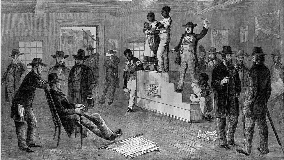 Auction sale for Negro slave family while perspective buyers look on smoking cigars, engraving, 1861. BPA2# 5154