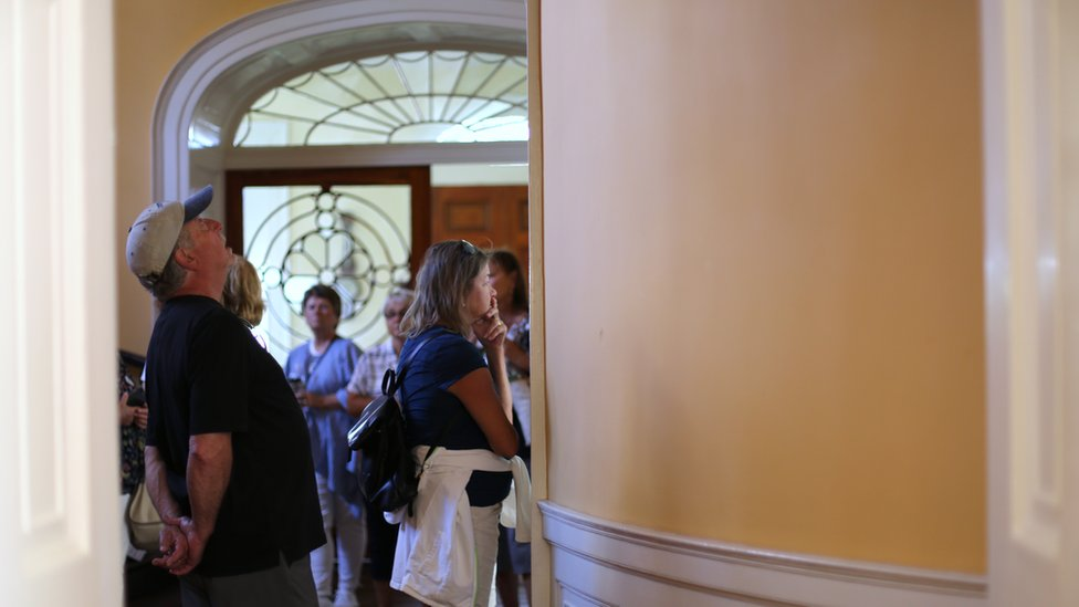 Tourists at the Nathaniel Russell House in Charleston