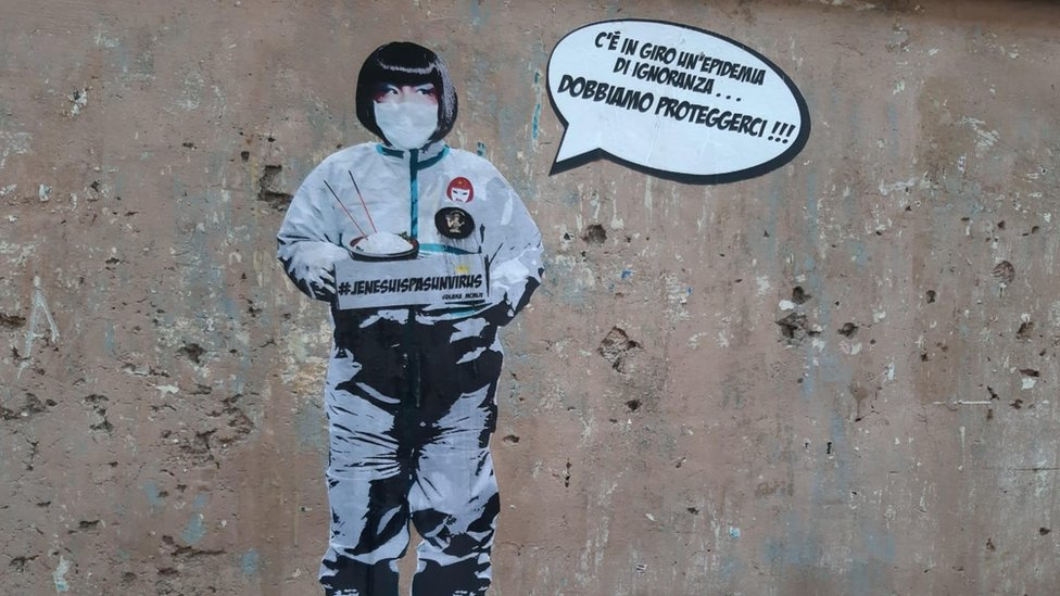 A view of a mural referring to the coronavirus outbreak that was created by the street artist Laika near Piazza Vittorio in the Chinese district of Rome, Italy, 4 February 2020