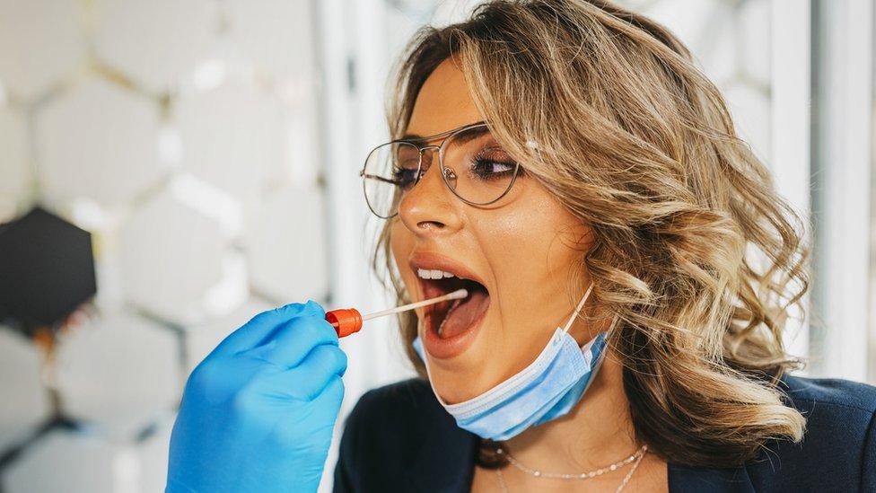 Woman being swab-tested