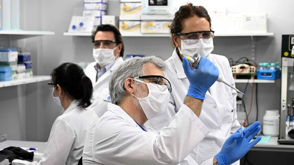 Technicians research Covid-19 at a lab in Buenos Aires, Argentina;