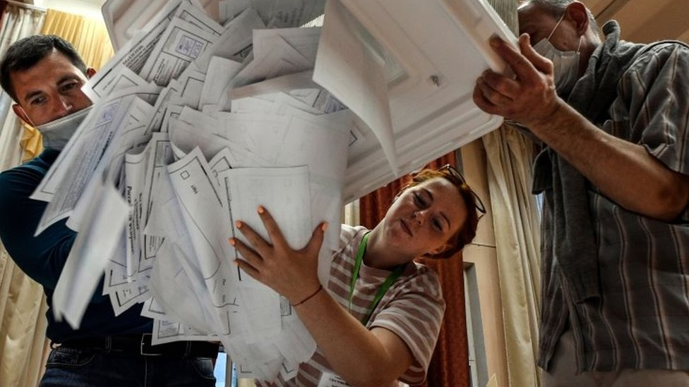 Election officials empty bulletins from a voting box at a poling station in Moscow, Russia. Photo: 1 July 2020