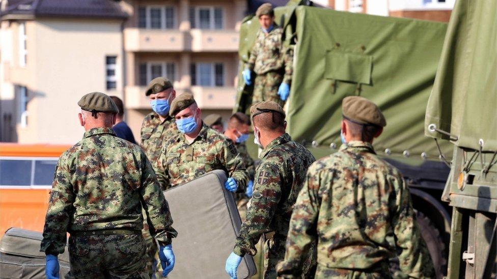 Soldiers prep a filed hospital in Novi Pazar