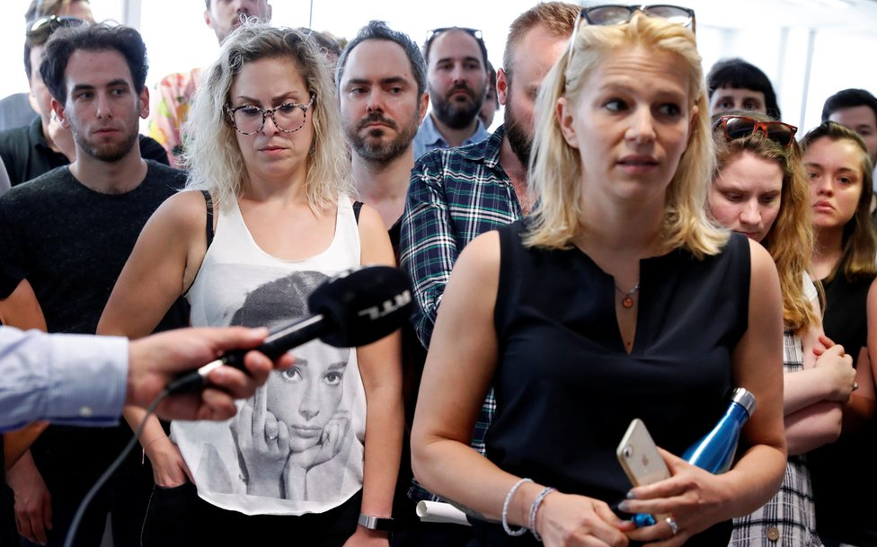Deputy editor in chief Veronika Munk speaks surrounded by employees at Index.hu on 24 July
