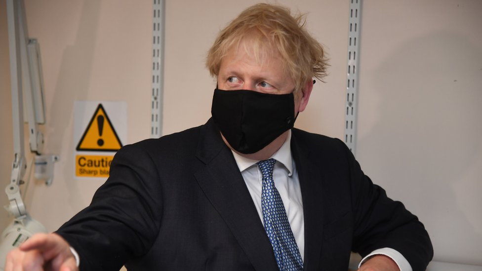 Boris Johnson wearing a face mask