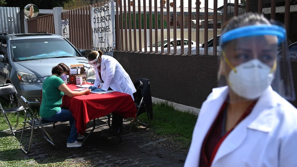 A woman fills out a form to donate blood in Mexico City on 30 June 2020