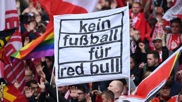 Bayern Munich fans hold a banner reading: 'Kein fussball fur Red Bull' (no football for Red Bull)