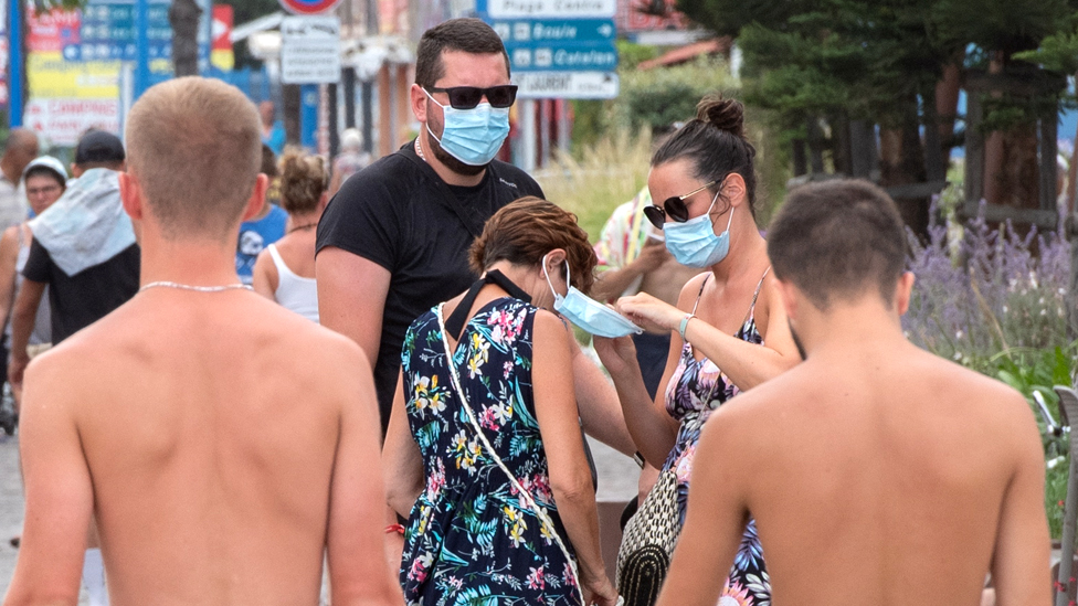 People adjust their masks in Argeles- sur-Mer, southern France