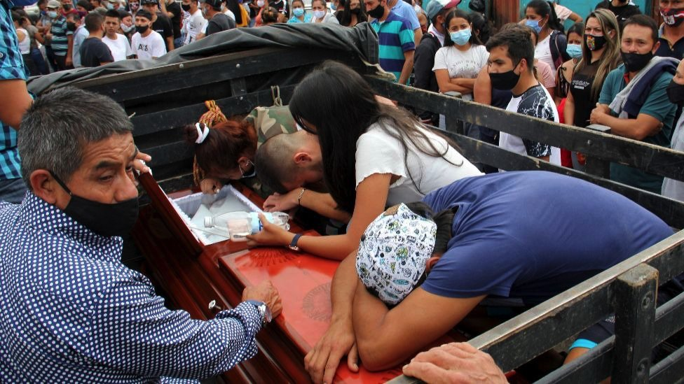 Family members bid farewell to one of the victims of the murder of nine people in Samaniego, Narino, Colombia, 16 August 2020.