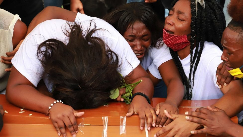 People cry during a funeral for five minors who were found dead in a sugar cane field, in Cali, Colombia August 14, 2020.