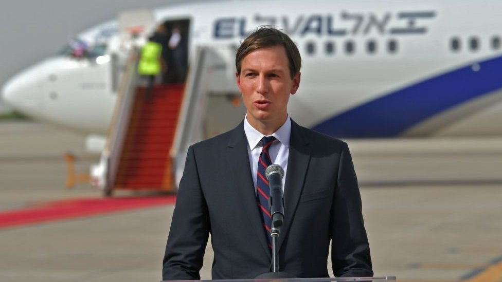 US Presidential Adviser Jared Kushner speaks in front of an air-plane of El Al at the Abu Dhabi airport