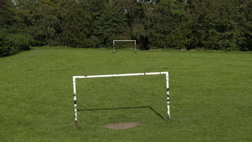 Goalposts in a field