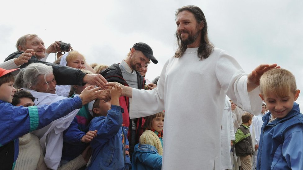 Image shows Sergei Torop with his followers in 2009