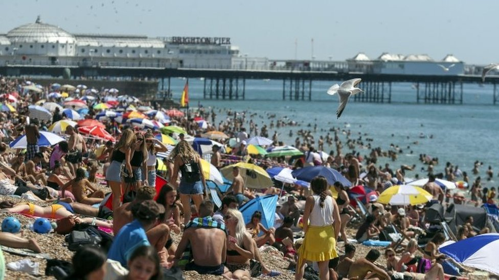 People at Brighton beach in August