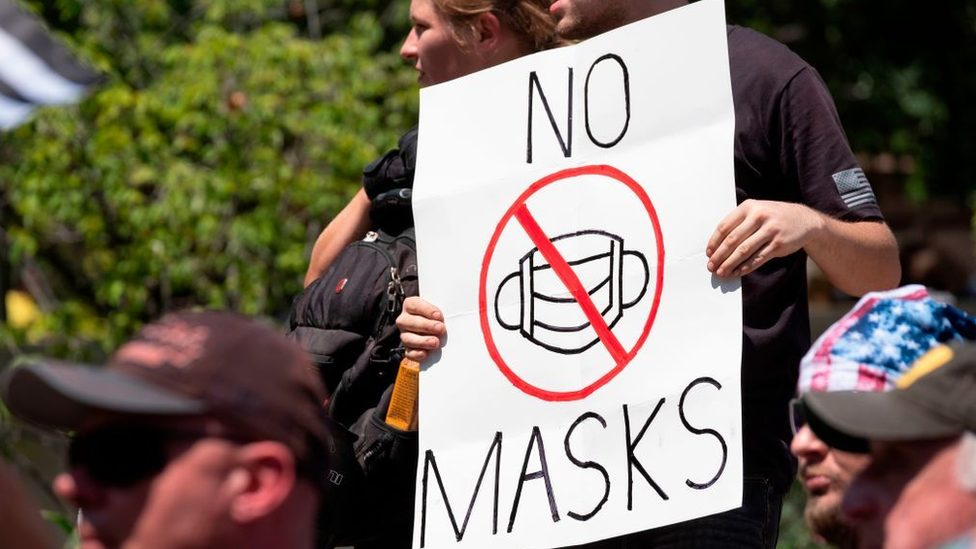 US demonstrators with a banner against the use of face masks
