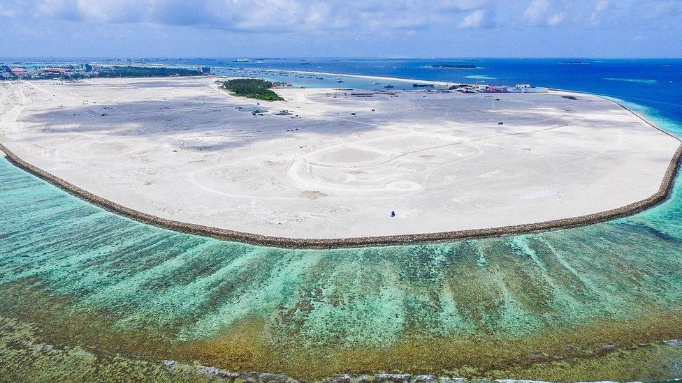 An aerial view of the emerging island built with sand