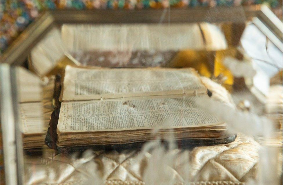 A Bible placed inside the casket of an organ clock